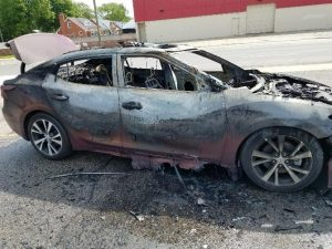 Burned Car from Exploding Samsung Cell Phone